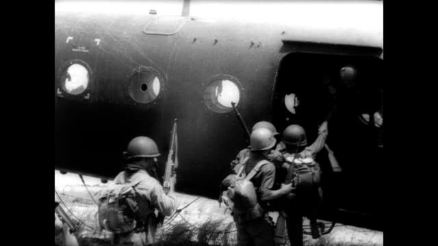 american military men talking in front of helicopter / us helicopters loaded with soldiers in a row ready for take off / soldiers with guns lean out... - vietnam stock videos & royalty-free footage