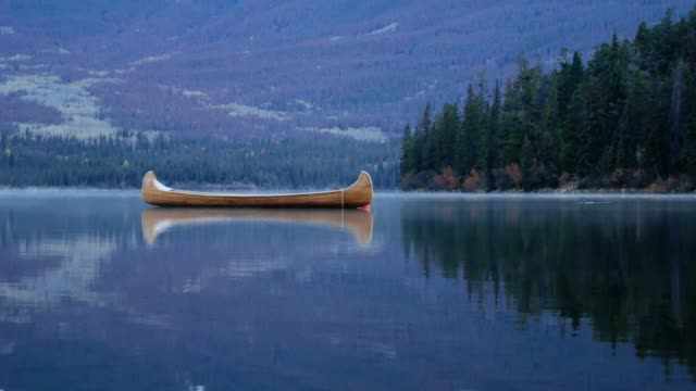 american native boat on pyramid lake , jasper national park , alberta , canada - jasper national park stock videos & royalty-free footage