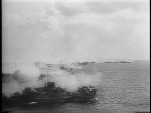american naval ships at sea / firing of guns on naval ships / navy seals cleaning up empty ammunition shell on a ship / naval aircraft carrier at sea. - グアム点の映像素材/bロール