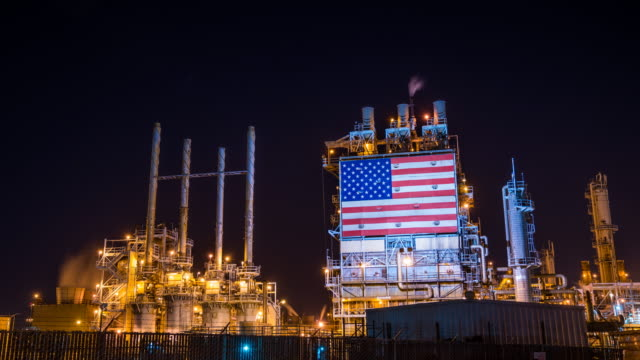 american oil refinery working through the night - refinery stock videos & royalty-free footage