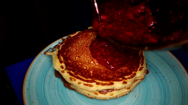 american pancakes for dessert topped with jam - jam stock videos & royalty-free footage