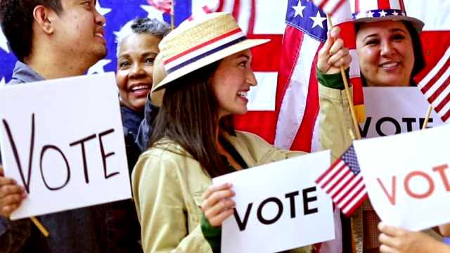 american people wave flags at political rally, convention - voting stock videos & royalty-free footage