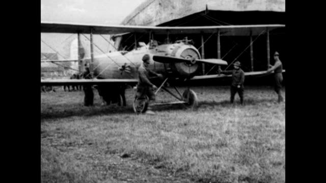 american planes being guided out of hangars / narrator explains america had '28 airplanes 65 pilots supplemented by 50 flying students' / seaplane... - narrating stock videos and b-roll footage