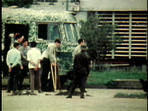 american pows are handed over by north vietnam ceremoniously as they salute american officer greeting them / vietnam - prisoner of war stock videos & royalty-free footage