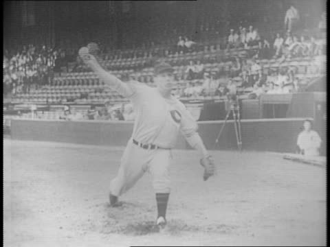 american professional baseball clubs contract / bob feller exits car / enters cleveland indians office / feller pitching brush playing catch with... - baseball pitcher stock videos & royalty-free footage