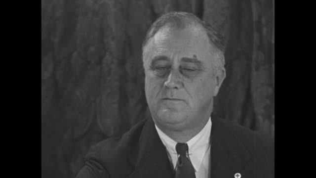 american red cross chairman cary t. grayson and a red cross nurse flank pres. franklin roosevelt, who sits in front of a large model of a sailing... - american red cross stock videos & royalty-free footage