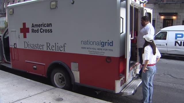 american red cross volunteers pack the disaster relief truck as they prepare to go help victims of hurricane matthew red cross new york city on... - red cross stock videos & royalty-free footage