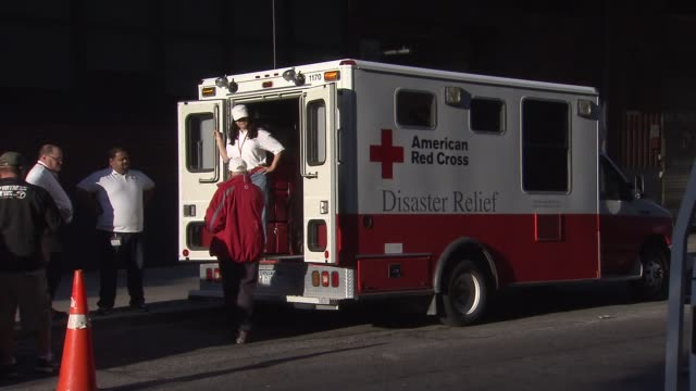 american red cross volunteers prepare the disaster relief truck and talk outside of the vehicle red cross new york city on october 07 2016 in new... - red cross stock videos & royalty-free footage