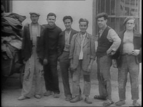 american rehabilitation program for spanish republicans who have been interned in french african camps / clothing sent by lehman committee for... - anno 1943 video stock e b–roll