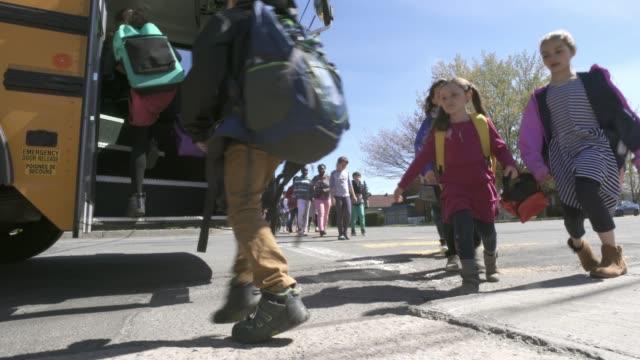 american school education activities children school bus - safety stock videos & royalty-free footage