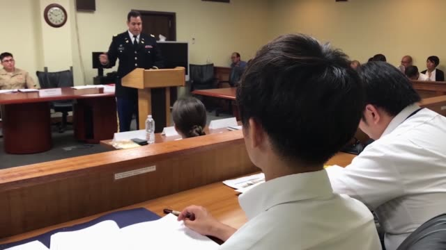 american service members joined japanese law enforcement and prosecutors in court for the military justice exhibition the exhibit simulated a trial... - 裁判点の映像素材/bロール