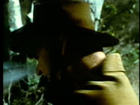stockvideo's en b-roll-footage met 1963 reenactment montage american settler pioneer chopping log with axe / 1820s texas / audio - manifest destiny