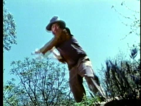 stockvideo's en b-roll-footage met 1963 reenactment montage american settler pioneer digging with pick-axe / 1820s texas / audio - manifest destiny