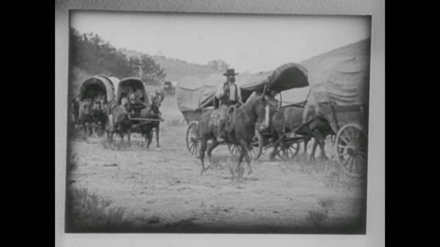 vidéos et rushes de 1938 american settlers cross the final frontier expanding west in covered wagons - ouest américain