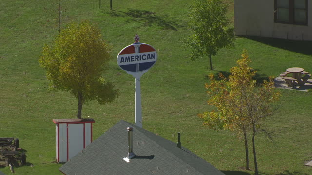 ms aerial pov american sign at buckstop junction / bismarck, north dakota, united states  - bismarck north dakota stock videos & royalty-free footage