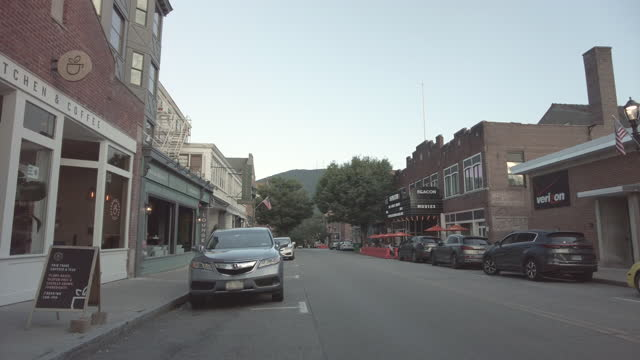american small town in upstate new york. a movie theater in the distance. some businesses and people walking on august 5, 2021 in beacon, new york. - street name sign stock videos & royalty-free footage