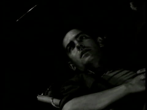 dramatization american soldier reclined in bunk sot talking about when war's over will go back to land his own farm bunkmate saying got to get home... - adagiarsi video stock e b–roll