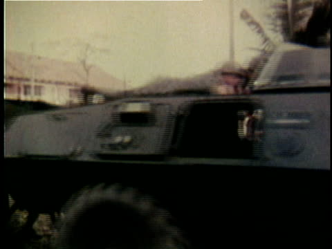 american soldiers advancing down city street behind armored vehicle during the tet offensive / vietnam - battle stock videos & royalty-free footage