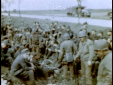 american soldiers and prisoners waiting by side of road / germany - prisoner of war stock videos & royalty-free footage