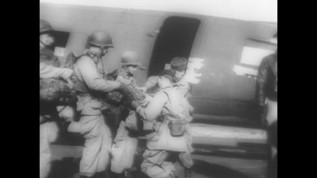 american soldiers assemble at british airbases to time dday landings during wwii - fallschirmjäger stock-videos und b-roll-filmmaterial