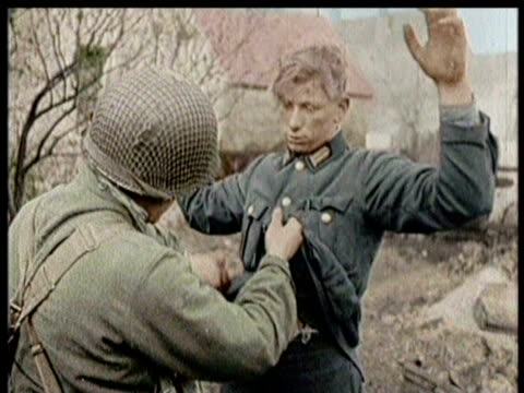 american soldiers capture german soldiers / americans search germans for weapons / crowds sill streets to cheer end of war - world war ii stock videos & royalty-free footage