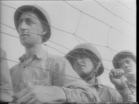 american soldiers dressed as nazis stand under nazi flag / truck full of soldiers pulls up to sign reading 'schichelgruber's pokey', soldiers dressed... - concentration camp stock videos & royalty-free footage