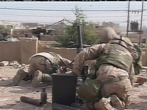 american soldiers fire mortar rounds off a rooftop in iraq. - (war or terrorism or election or government or illness or news event or speech or politics or politician or conflict or military or extreme weather or business or economy) and not usa stock videos & royalty-free footage