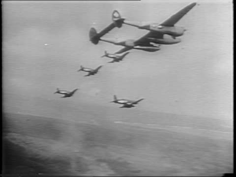 vidéos et rushes de american soldiers fire rifles and throw hand grenades / explosions on the ground / planes taxi on a runway / aerials views as corsair bombers drop... - 1945