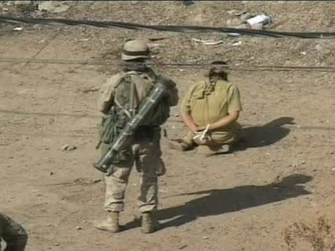 american soldiers guard an iraqi captive. - guantanamo bay stock videos & royalty-free footage