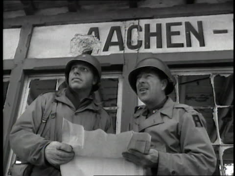 american soldiers look at a map during the battle of aachen. - 1944 stock videos & royalty-free footage