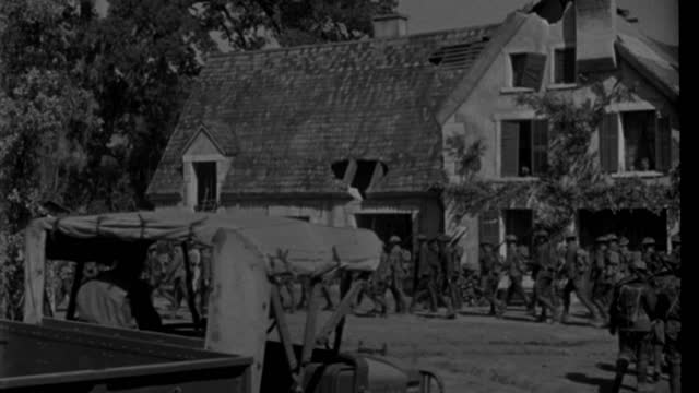 american soldiers march through a bombed french village. - 1920 1929 stock videos & royalty-free footage