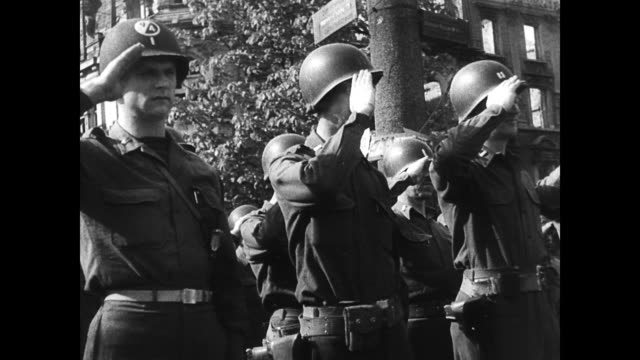 american soldiers on parade in bombed out cologne / cu of individual soldier's faces american soldiers arrive in cologne for reconstruction on... - 1945 stock-videos und b-roll-filmmaterial
