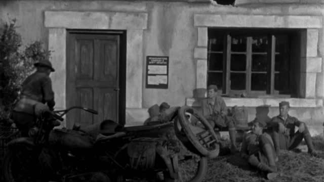 american soldiers rest in front of a french inn as a dispatch rider arrives on a motorcycle. - 1920 1929 stock videos & royalty-free footage