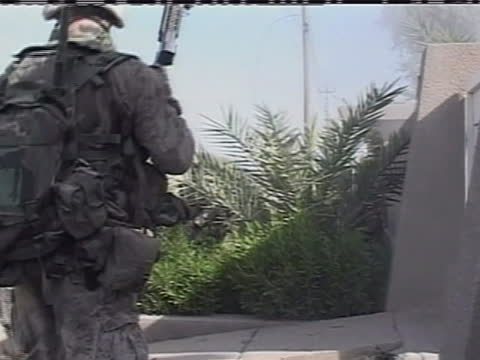 american soldiers rush into a building in iraq. - (war or terrorism or election or government or illness or news event or speech or politics or politician or conflict or military or extreme weather or business or economy) and not usa stock videos & royalty-free footage