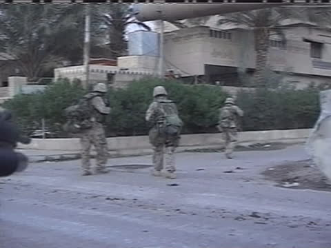 american soldiers shoot at a building in iraq. - (war or terrorism or election or government or illness or news event or speech or politics or politician or conflict or military or extreme weather or business or economy) and not usa stock videos & royalty-free footage