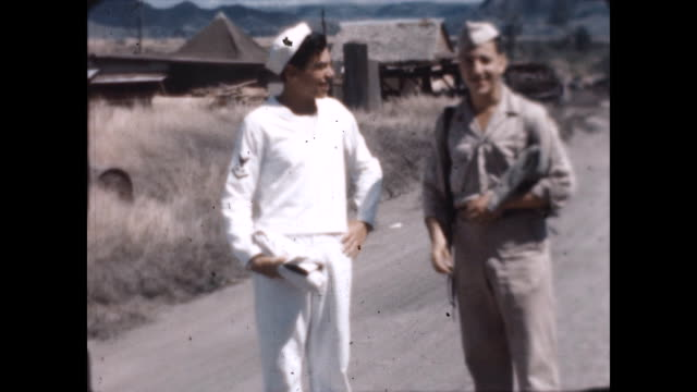 american soldiers stationed at clark airfield in luzon enjoy chatting with each other. they want away together and one waves at the camera. - us navy stock videos & royalty-free footage