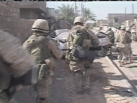 american soldiers walk through the streets of iraq. - (war or terrorism or election or government or illness or news event or speech or politics or politician or conflict or military or extreme weather or business or economy) and not usa stock videos & royalty-free footage