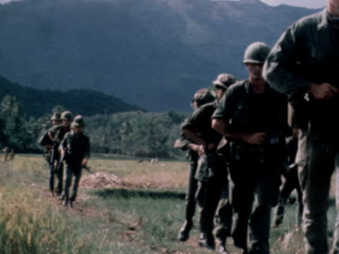 american soldiers walking through field in vietnam - vietnam war stock videos & royalty-free footage