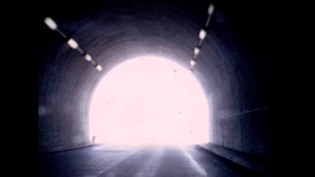 1965 american southwest road trip, light in tunnel - light at the end of the tunnel stock videos and b-roll footage