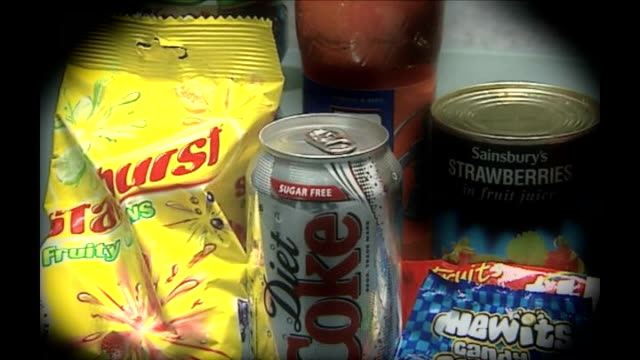 american study debunks health myths; graphicised seq various sugary foods including diet coke and chewits - itvイブニングニュース点の映像素材/bロール