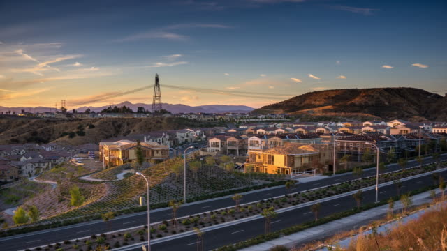 american suburb under construction at sunset - time lapse - santa clarita video stock e b–roll