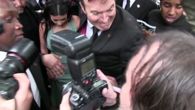 american tabloid fave kim kardashian leaving the valentino fashion show and create a madness walking half a mile surrounded by fans. what a mayhem on... - ファッションコレクション点の映像素材/bロール
