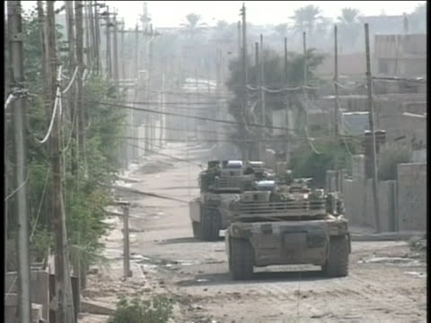 american tanks patrol the streets of iraq. - (war or terrorism or election or government or illness or news event or speech or politics or politician or conflict or military or extreme weather or business or economy) and not usa stock videos & royalty-free footage