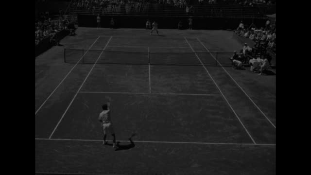 american team wearing tennis clothes and white jackets comes to court during davis cup elimination round / fumiteru nakano serves to dick savitt / vs... - davis cup stock-videos und b-roll-filmmaterial