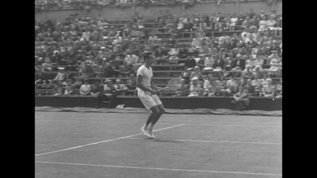 American tennis player Tom Brown takes the court at Wimbledon with Yvon Petra of France during men's quarterfinals / montage Petra serves returns /...