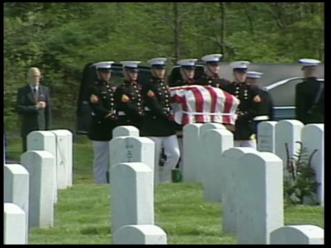 american troops killed since fall of baghdad; itn usa: ext coffin draped in us flag carried along at funeral of soldier killed in iraq soldiers... - coffin stock videos & royalty-free footage