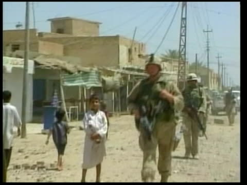 american troops killed since fall of baghdad; lib mat held washington = no resale. iraq: ext us soldiers patrolling street int soldiers searching... - searching点の映像素材/bロール