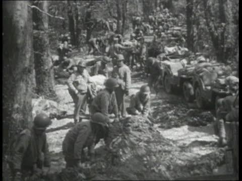 american troops preparing for battle in woods - 1943 stock videos & royalty-free footage