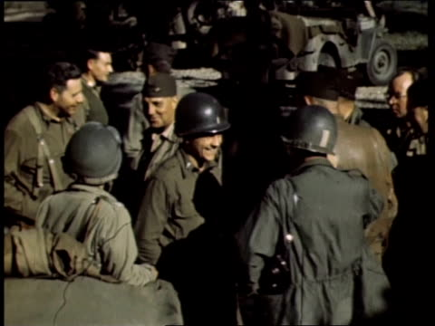 american troops preparing for entering paris in armored vehicles, reading maps and talking / brittany, france - 1944 stock videos & royalty-free footage