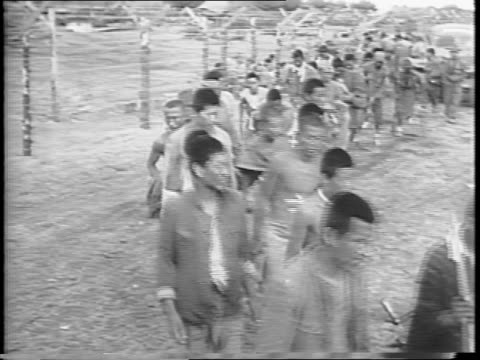 american troops transport japanese prisoners of war by trucks to a prison camp in okinawa / wide shot tents in camp / prisoners jump off truck /... - prison camp stock videos & royalty-free footage